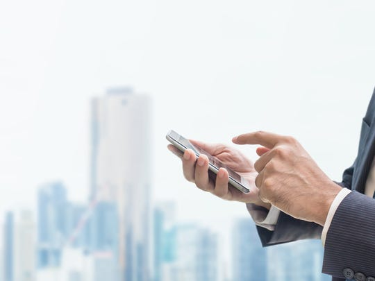A businessman uses his smartphone.