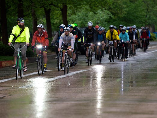 Cyclists process down Mountain Avenue in during the Ride of Silence in Fort Collins Wednesday, May 21, 2014. The ride is a worldwide event where bicyclists ride in silence to raise cycling safety awareness and serve as a chance to mourn those who have been killed.