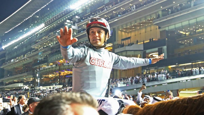 DUBAI, UNITED ARAB EMIRATES - MARCH 26:  Victor Espinoza celebrates after riding California Chrome to victory in the Dubai World Cup Sponsored By Emirates Airline as part of the Dubai World Cup at Meydan Racecourse on March 26, 2016 in Dubai, United Arab Emirates.  (Photo by Warren Little/Getty Images)
