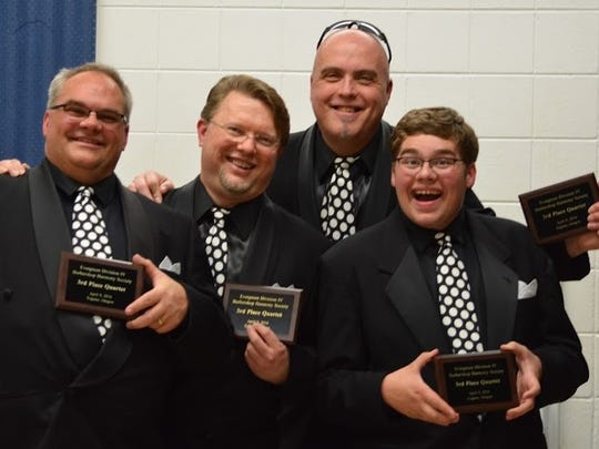 "Joe Eckstine, from left, Aaron Cermak, Mark Gross and Noah Eckstine pose after their quartet ""Jam 'N"" won third place."