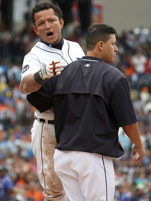 838627458.jpg DETROIT, MI - AUGUST 24: Miguel Cabrera #24 of the Detroit Tigers is held back during a sixth inning bench clearing fight with the New York Yankees at Comerica Park on August 24, 2017 in Detroit, Michigan.  (Photo by Gregory Shamus/Getty Images)