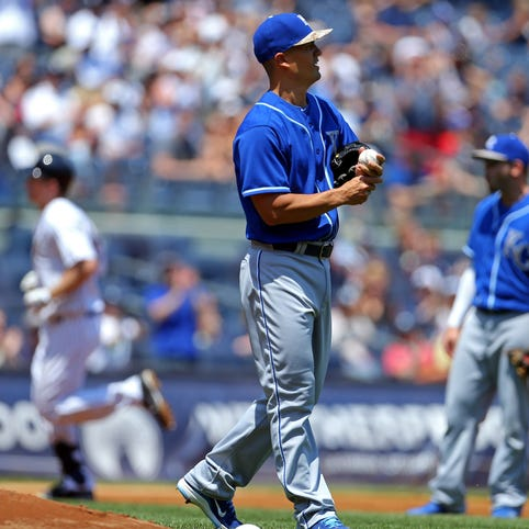 Royals pitcher Jeremy Guthrie reacts after giving up a two-run home run to Yankees third baseman Chase Headley.