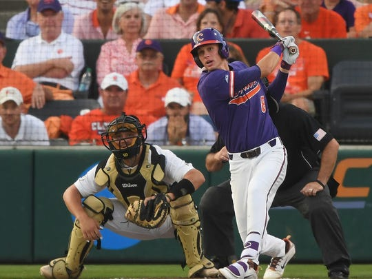Clemson's Logan Davidson (8) hits an RBI-single in the top of the second inning during an NCAA college baseball regional game against Vanderbilt, Saturday, June 2, 2018, in Clemson, S.C. (Bart Boatwright/The Greenville News via AP)