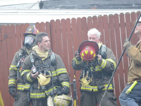 York City Assistant Fire Chief Greg Altland, second