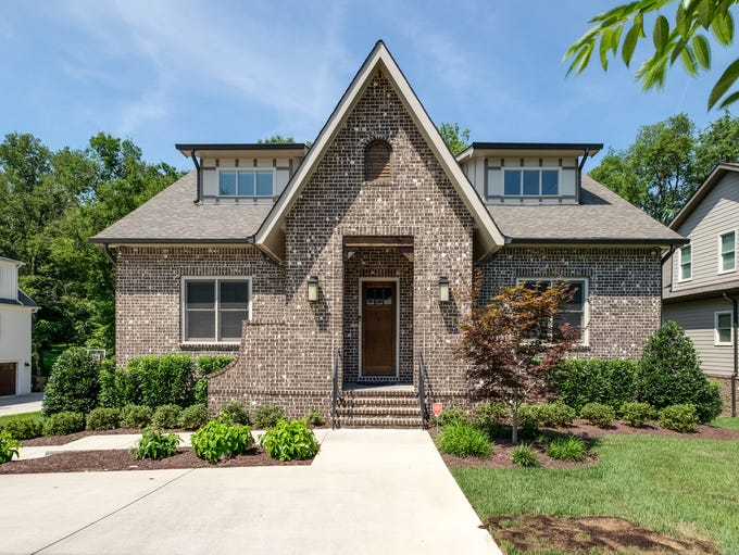 This 5-bedroom and 4.5-bathroom home in Green Hills