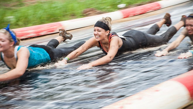 A 60-foot water slide is among the 25 obstacles at the Rugged Maniac 5k Obstacle Race at Wild Horse Pass Motorsports Park.