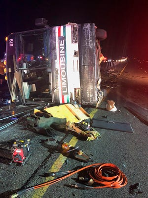 A bus is shown at the scene of a multivehicle deadly crash Sunday on Interstate 25 just north of Bernalillo, N.M.