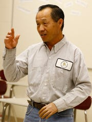 Wausau East High School custodian Chong Lee, expresses appreciation the school's club raised money to pay for the cost of his prosthetic arm.