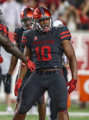 Houston defensive tackle Ed Oliver celebrates after a play against Louisville in 2016.