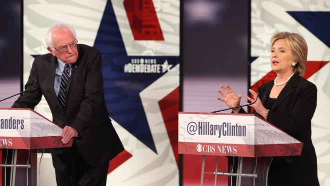 Democratic presidential rivals Sen. Bernie Sanders, I-Vt., and former Secretary of State Hillary Clinton, shown here at a Nov. 14, 2015, debate in Iowa, will debate again Thursday, Feb. 4, in New Hampshire.