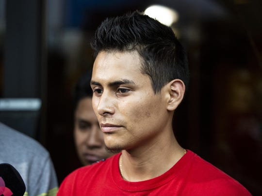 Surrounded by family members and supporters, Marlen Ochoa-Lopez's husband, Yiovanni Lopez, talks to reporters outside the Cook County medical examiner's office after identifying his wife's body, Thursday, May 16, 2019 in Chicago. (Ashlee Rezin/Chicago Sun-Times via AP)