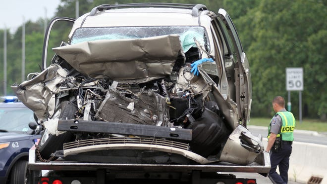 A van that had struck the rear of a tractor trailer on Route 37 eastbound at Colonial Drive in Manchester Tuesday is prepared to be towed from the scene.