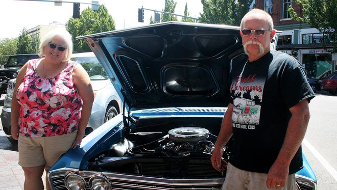 Katrina and Mike Adams show off one of the classic cars that will be on display at the Micro-Fest car show.