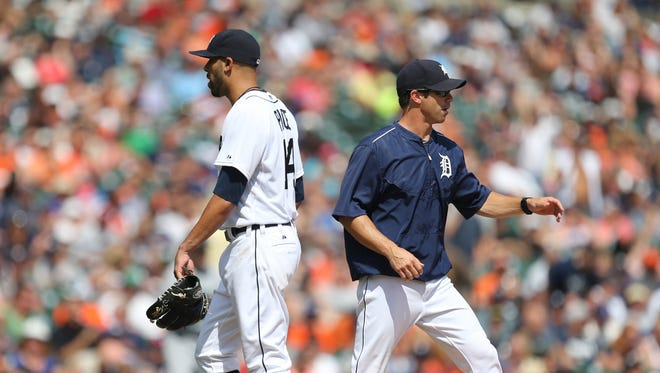 Detroit Tigers manager Brad Ausmus takes David Price out during ninth-inning action against the Seattle Mariners  on July 23, 2015 at Comerica Park in Detroit.