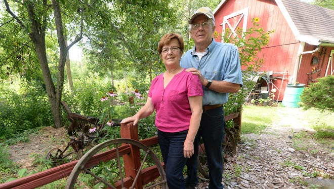 Ken and Judy Sikora moved to Howard in 1972 from Michigan's Upper Peninsula. What was once bare, flat land now flourishes with more than 400 trees and countless gardens.
