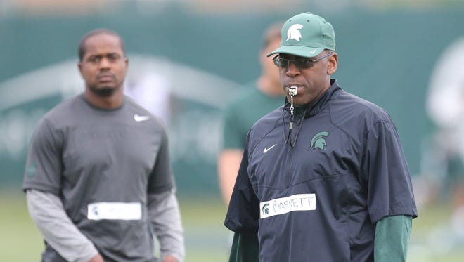 Michigan State Spartan co-defensive coordinator Harlon Barnett watches defensive drills during practice on Saturday, August 8, 2015 at the Duffy Daugherty football building in East Lansing Michigan.