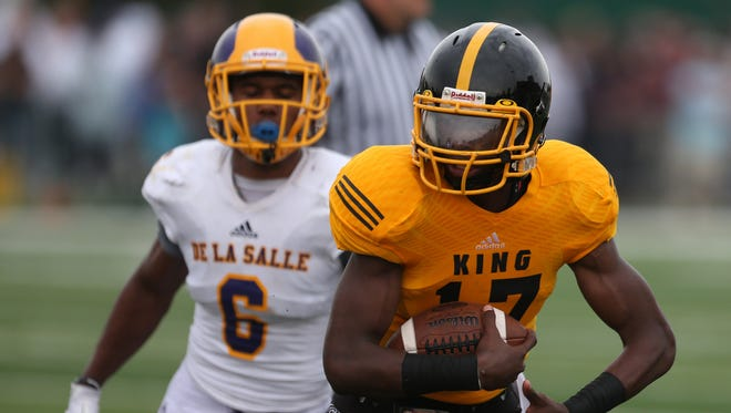 Detroit Martin Luther King's  Martinez Adams Calloway runs by Warren De La Salle's  Kevin Lee for a touchdown during second half action August 29, 2015 at Wayne State's Tom Adams Field in Detroit.