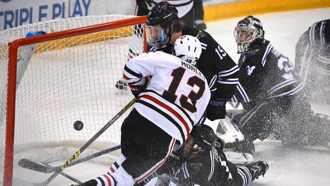 St. Cloud State's David Morely gets a shot past Minnesota State-Mankato's Carter Foguth (5), Brad McClure (19) and goaltender Cole Huggins to score in the first period of Friday's game at the Herb Brooks National Hockey Center in St. Cloud.