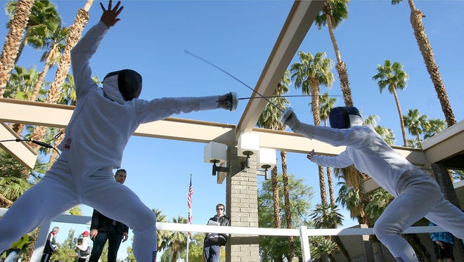 Fencers Ilia Frolov, left, of Russia and Michel Michalik, of Czechoslovakia compete in the 2013 Modern Pentathlon World Cup Series in Palm Springs on Friday, February 22nd, 2013.