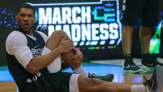 Michigan State Spartans forward Marvin Clark Jr. stretches during practice on Thursday, March 17, 2016, in St. Louis, Mo.