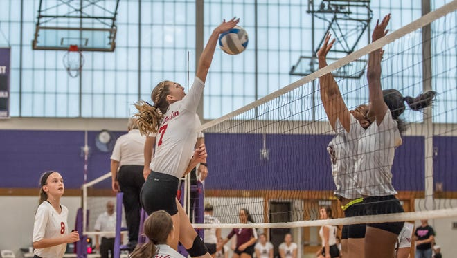 St Philip sophomore Maya Segovia goes for the kill during the Cereal City Volleyball Tournament at Lakeview on Saturday.