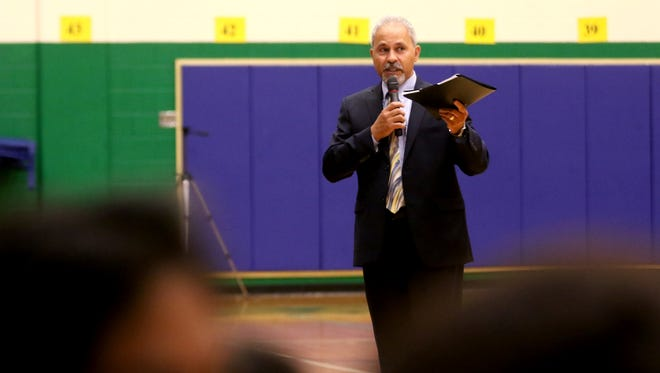 Salam Noor, the Deputy Superintendent of Public Instruction, welcomes students on the first day back to school for freshmen at McKay High School on Tuesday, Sept. 6, 2016.