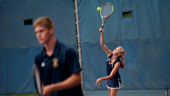 Owosso tennis junior Anna Raffaelli plays in doubles with her partner Cole Mallory against Mason on Thursday, Sept. 22, 2016 at Mason High School. Raffaelli is playing during the boys season in order to play soccer in the spring.