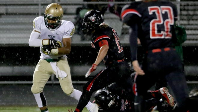 McKay's Jamer Silva (80) catches the ball in the McKay vs. North Salem football game at North Salem High School on Friday, Oct. 21, 2016.