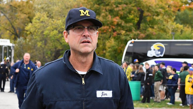 Oct 29, 2016; East Lansing, MI, USA; Michigan Wolverines head coach Jim Harbaugh arrives before the game against the Michigan State Spartans at Spartan Stadium.