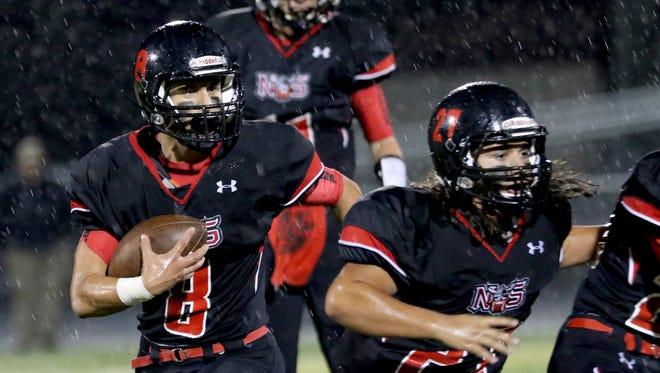 North Salem's Alex Vasquez (8) rushes with the ball in the McKay vs. North Salem football game at North Salem High School on Friday, Oct. 21, 2016.