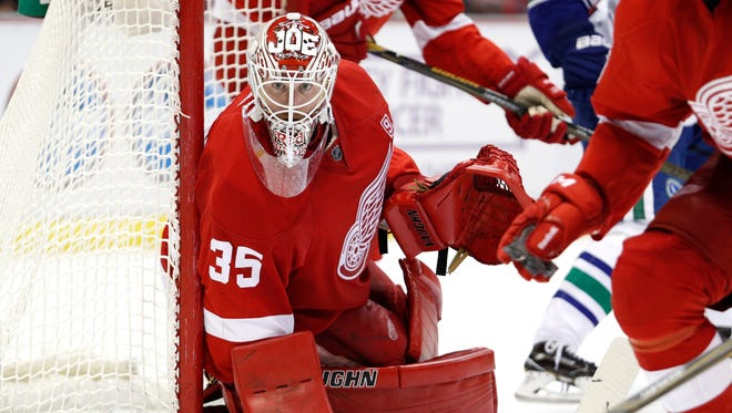Nov 10, 2016; Detroit, MI, USA; Red Wings goalie Jimmy Howard blocks the side of the goal during the third period against the Vancouver Canucks at Joe Louis Arena.