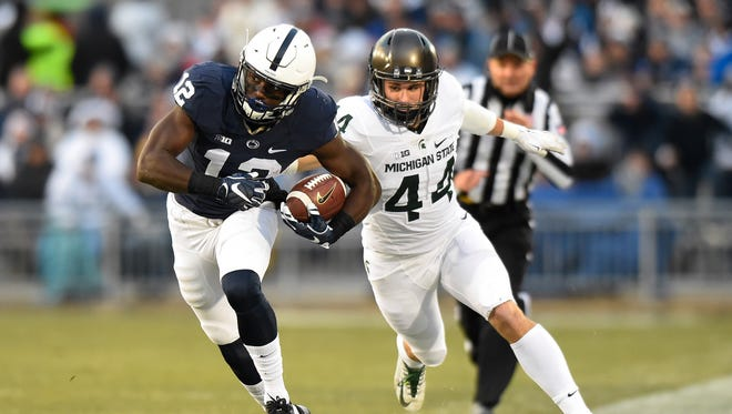 Nov 26, 2016; University Park, PA, USA; Penn State Nittany Lions wide receiver Chris Godwin runs with the ball in front of Michigan State Spartans safety Grayson Miller during the first quarter at Beaver Stadium.