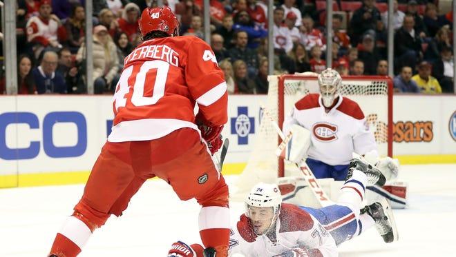 Nov 26, 2016; Detroit, MI, USA; Montreal Canadiens defenseman Alexei Emelin blocks a shot by Detroit Red Wings left wing Henrik Zetterberg at Joe Louis Arena.