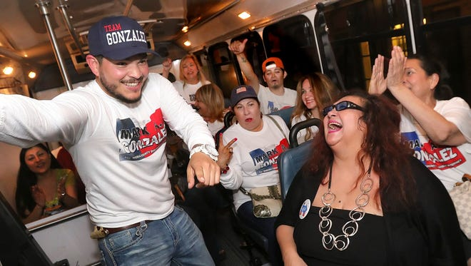 Mark Gonzalez and a group of supporters prepare to leave for the Nueces County Courthouse aboard the campaign bus with La Lisa Hernandez at right at Tannins in Corpus Christi, Tuesday, March 01, 2016.