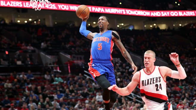 Jan 8, 2017; Portland, OR, USA; Pistons guard Kentavious Caldwell-Pope goes up for a dunk over Trail Blazers center Mason Plumlee at Moda Center.