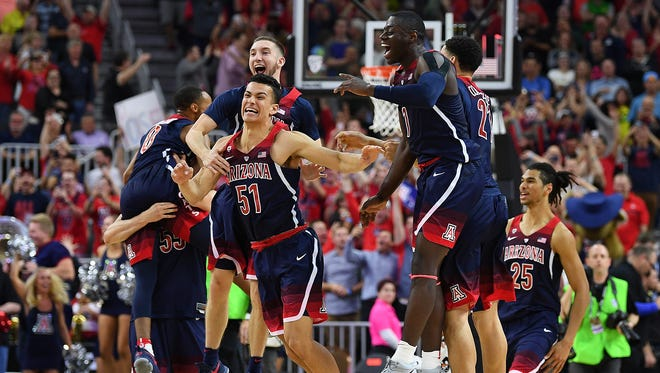 Mar 11, 2017: Arizona Wildcats players celebrate after defeating the Oregon Ducks 83-80 in the Pac-12 Conference Championship game at T-Mobile Arena.