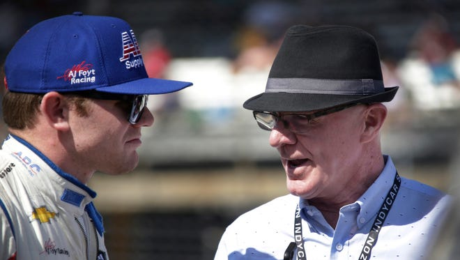 Conor Daly, who drives the No. 4 ABC Supply Co. Chevrolet  for A.J. Foyt Enterprises gets some advice from his father and former racer himself Derek Daly before a practice run at the Indianapolis Motor Speedway Friday May 26, 2017.