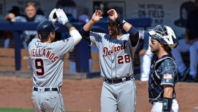Tigers third baseman Nick Castellanos (9) is congratulated by rightfielder J.D. Martinez (28) after driving them both in with a two run home run during the sixth inning as Padres catcher Austin Hedges (right) looks during the Tigers' 7-5 win Sunday in San Diego.