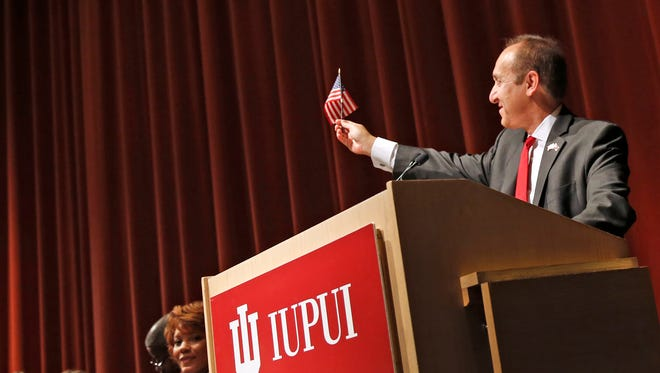IUPUI Chanellor Nasser Paydar waves his American flag he got when he became an American citizen in 1992, as he speaks during a Naturalization Ceremony for the newest American citizens at IUPUI, Thursday, April 27, 2017.  This was the first naturalization ceremony to be held at an Indianapolis College or University campus.  The almost 100 new citizens came from 38 countries.  Paydar told of his experiences becoming an American, immigrating from Iran.