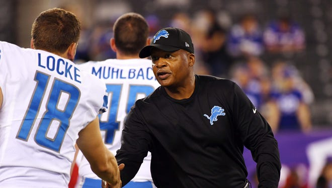 Lions coach Jim Caldwell shakes the hand of punter Jeff Locke before the game against the Giants at MetLife Stadium on Sept. 18, 2017; East Rutherford, N.J.
