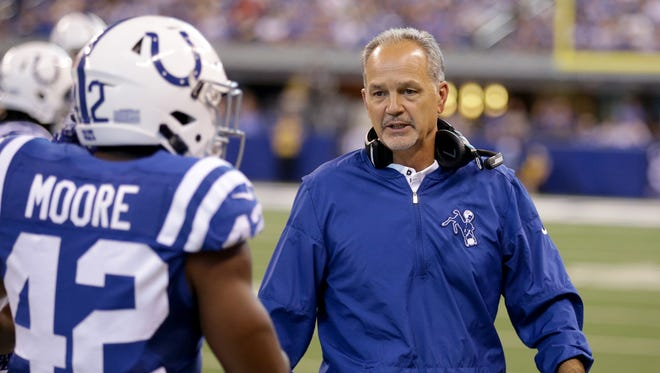 Indianapolis Colts head coach Chuck Pagano wants to talk to  Kenny Moore (42) after he is called for unnecessary roughness in the second half of their game at Lucas Oil Stadium Sunday, Sept, 17, 2017. The Colts lost to the Cardinals 16-13 in overtime.