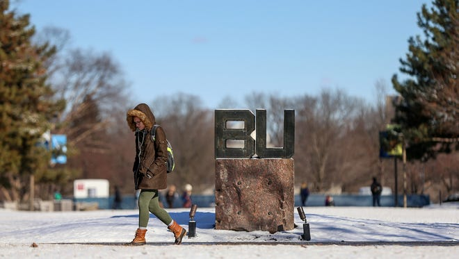 A student bundled up in winter clothing passes by the BU sign at Butler University, Indianapolis, Thursday, Feb. 9, 2017.