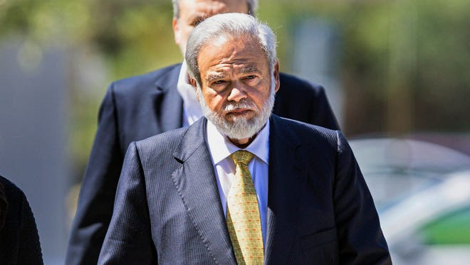 In this April 28, 2017 file photo, Dr. Salomon Melgen arrives at the federal courthouse in West Palm Beach, Fla.