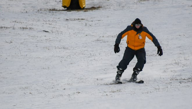 A skier makes his way down a barely snow-covered slope at Sunlight Mountain Resort in Glenwood Springs, Colo., on  Jan. 5, 2018.