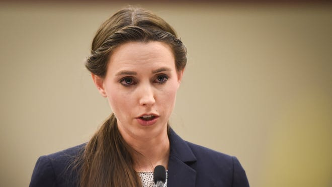 """""""Was it the right way or the wrong way,"""" Rachael Denhollander says as she addresses Circuit Judge Rosemarie Aquilina about Michigan State University's response to allegations of sexual abuse, Wednesday, Jan. 24, 2018, during the sixth day of victim impact statements in Ingham County Circuit Court.   Nassar is expected to be sentenced on seven sexual assault charges today."""