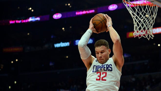 Clippers forward Blake Griffin grabs a rebound against the Timberwolves during the first half at Staples Center in Los Angeles on Jan. 22, 2018.