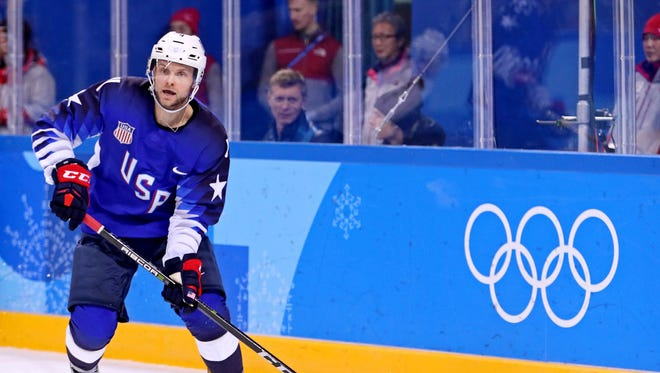 U.S. defenseman Chad Billins clears the puck against Slovenia in during play at the 2018 Olympic Winter Games at Kwandong Hockey Centre.