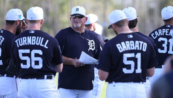 Detroit Tigers pitching coach Chris Bosio, center, talks during spring training Wednesday, Feb. 21, 2018 at Joker Marchant Stadium in Lakeland, Fla.