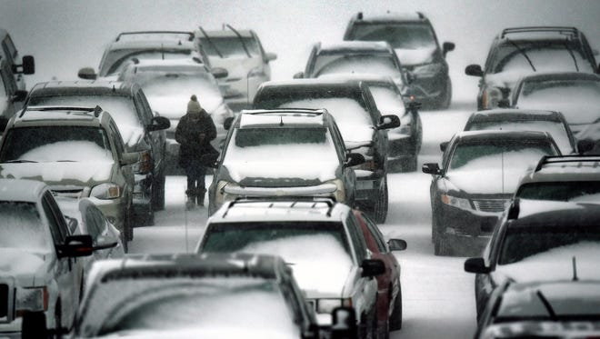 Heavy snow falls on cars parked in the lot at the St. Cloud Municipal Athletic Complex Saturday afternoon, Feb. 24, in St. Cloud.