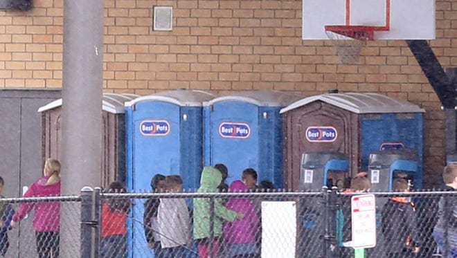 Students use portable toilets at Battle Creek Elementary School in Salem on Thursday, March 8, 2018.
